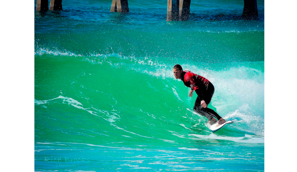 """Justin Buxton working his line in Mr. Surf\'s Cold Water Classic surf competition. Photo: <a href=\""""https://richbrooksphotography.squarespace.com/\"""">Rich Brooks</a>"""