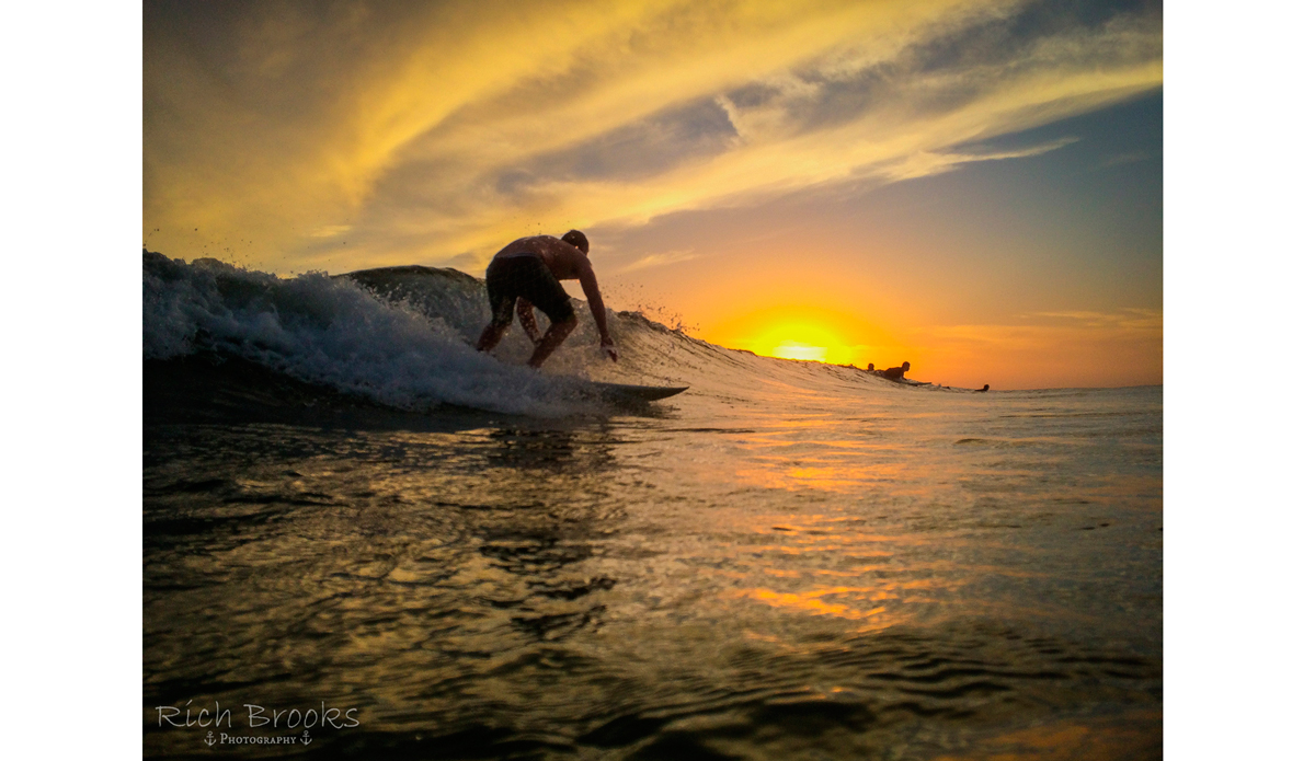 "Take a left, and you can enjoy a stunning sunset as you cruise down the line. (Surfer: Alex Wood) Photo: <a href=""https://richbrooksphotography.squarespace.com/\"">Rich Brooks</a>"