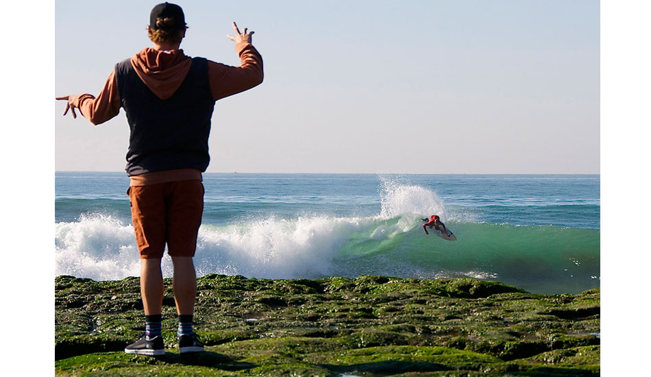Matt Meyers finger surfing while Buddy Frietas dose the real thing. Photo: Robb Wilson