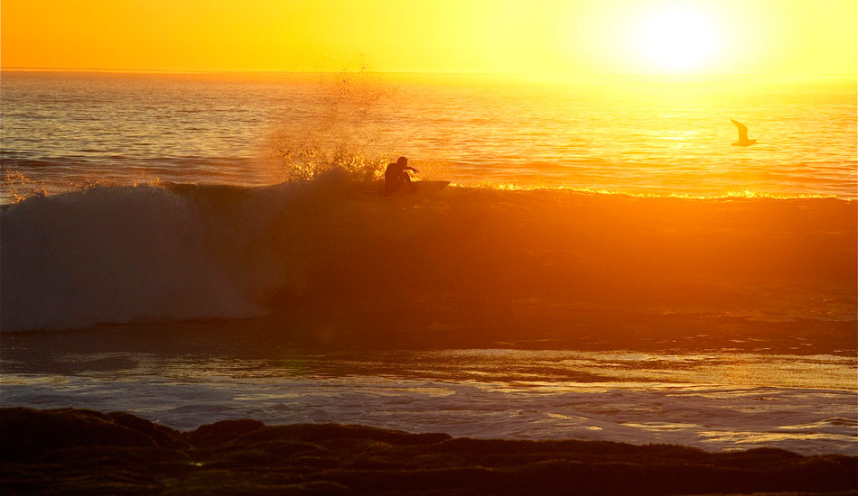Tyler Fox isn\'t just about huge waves. He\'s also about doing massive functional floaters during golden hour. He stuck this. Photo: Robb Wilson