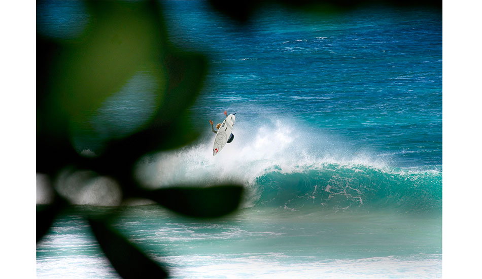 """Plain and simple, my buddy Noah \""""Waggy\"""" Wegrich goes off! He and I were on the North Shore together late last season. I took this shot of him at Off The Wall. He doesn\'t care if it\'s dry reef, he was going ballistic. Photo: Robb Wilson"""