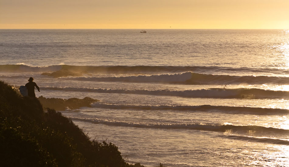 Jamie Sterling, running out for a couple more at sunset. Chile. Photo: Rusty Long