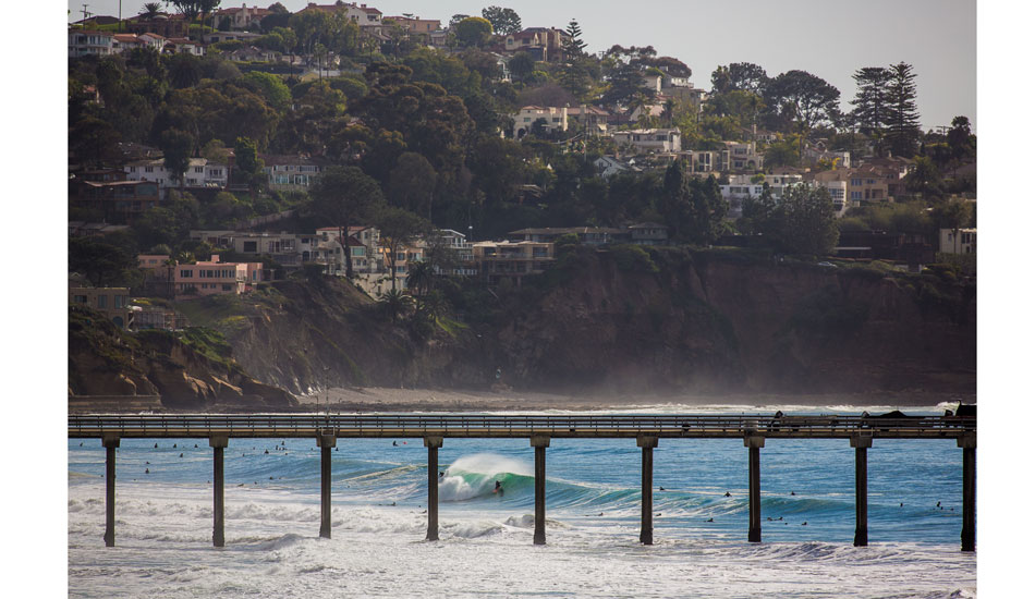 "Looking south through the Scripps Pier with Mt. Soledad in the background. John Haffey, slotted. Photo: <a href=""http://anthonyghigliaprints.com\"">Anthony Ghiglia</a>"