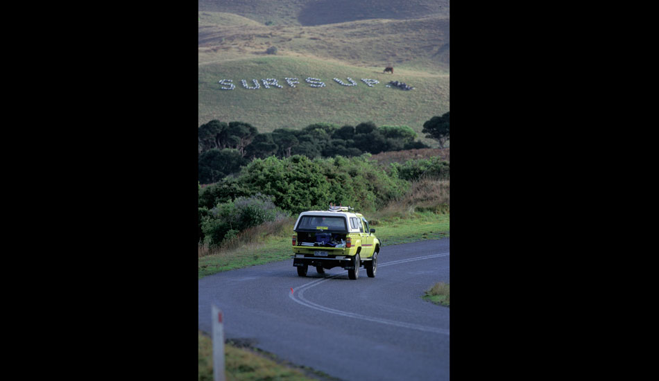 """One of the local farmers writes messages on the side of the hill with tires that he has painted white. He obviously had heard through the grapevine that we were coming.  Photo: <a href=\""""http://seandavey.com/\"""" target=_blank>Sean Davey</a>"""