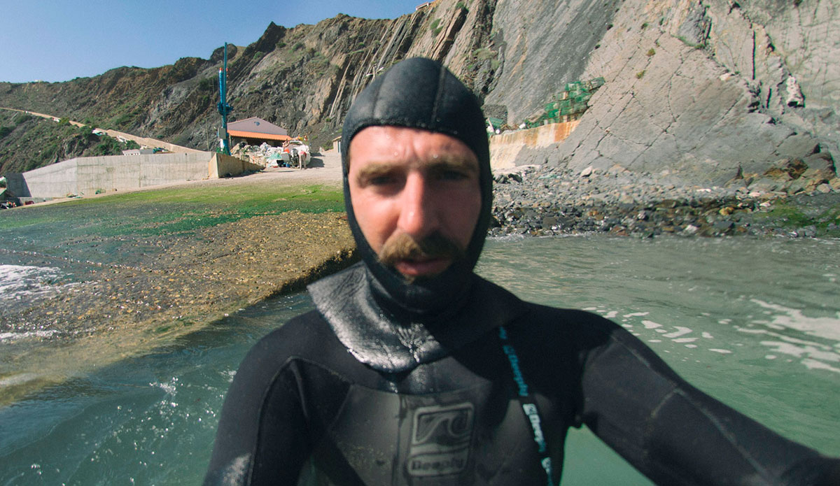 """Going out in a big wave spot in Aljezur, I had to use this ridiculous ultra-tight hood because of my surfer\'s ear. <a href=\""""http://joaobracourt.com/\"""">João Bracourt</a>"""