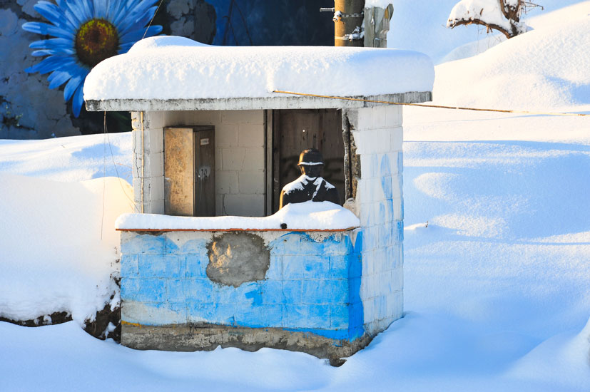 """One of the ROK decoy stations. The plastic soldier is covered after a massive snowfall in January. Photo: <a href=\""""http://www.shannonaston.com/\"""" target=_blank>Shannon Aston</a>."""