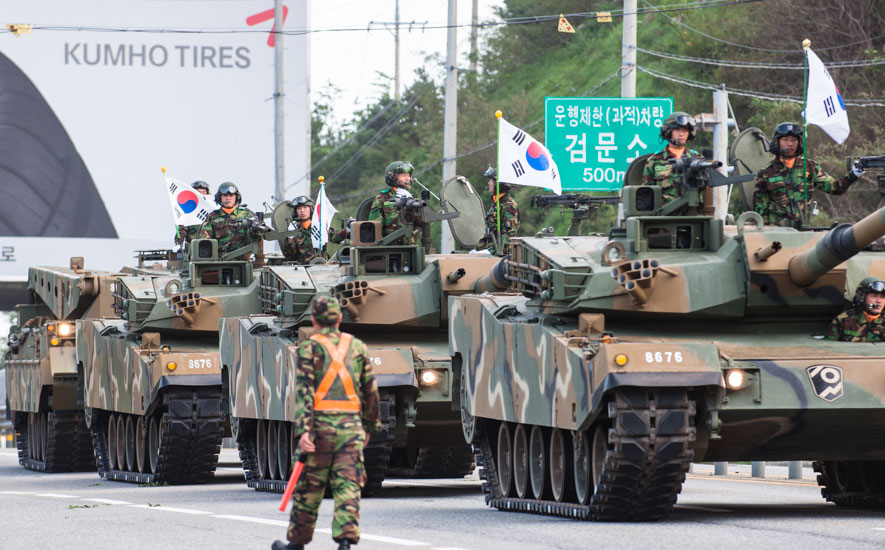 """ROK tanks parade down the highway during a military exercise and parade day which celebrated a South Korean military memorial. The Army is always present in this heavily-defended area. Photo: <a href=\""""http://www.shannonaston.com/\"""" target=_blank>Shannon Aston</a>."""