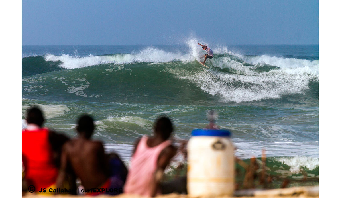 """Erwan Simon putting on a show for the boys from the village, who walked two hours from their village to watch. Photo: <a href=\""""http://surfexplore.info/\"""">surfEXPLORE</a>/John Seaton Callahan"""