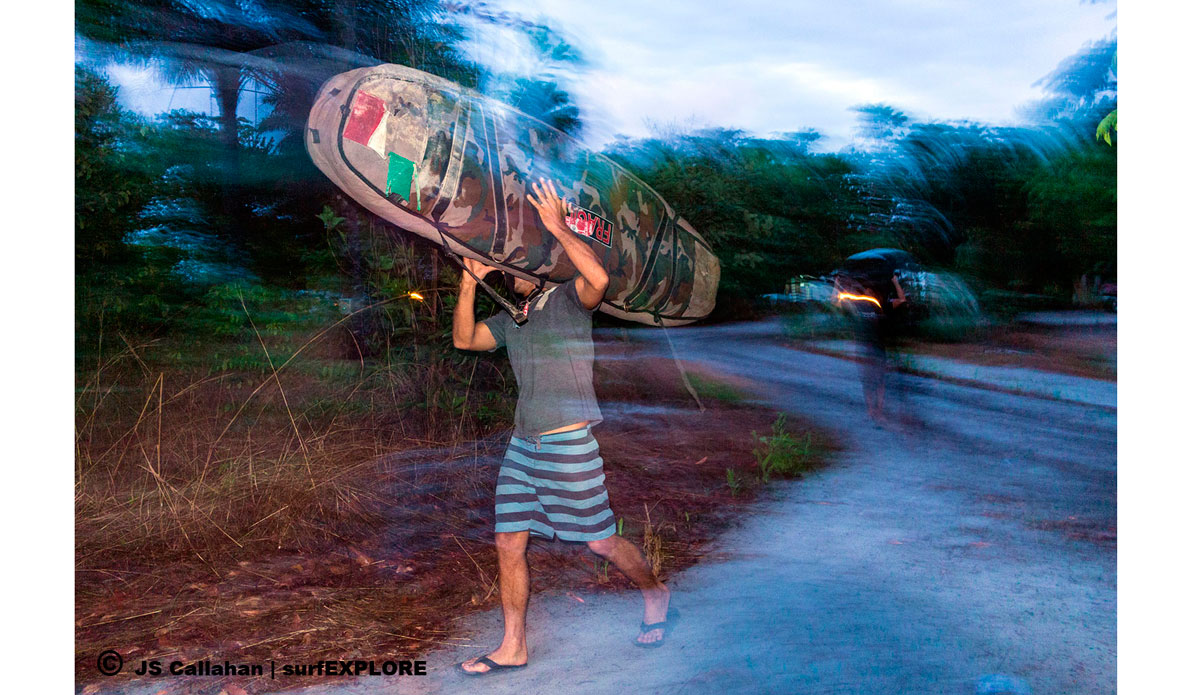 """A trip is not all fun and waves, hauling boards after a long travel day of boats and cars. Photo: <a href=\""""http://surfexplore.info/\"""">surfEXPLORE</a>/John Seaton Callahan"""