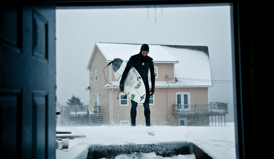 "The East Coast of Canada is damn cold. After getting changed in the basement of a friend\'s house, Peter Devries headed out for a surf. Air temp: -20C, water temp: 0C. Photo: <a href=""http://www.jeremykoreski.com/\"" target=_blank>Jeremy Koreski</a>"