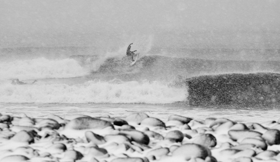 Nico Manos, on possibly the snowiest day that I\'ve attempted to take surf photos on. Photo: Zak Bush
