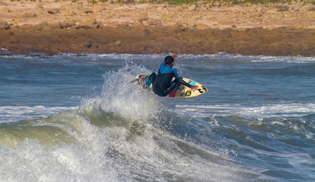 "Mini grom Dillen Hendricks pushing S.A junior surfing with jumps like this. Photo: <a href=""https://www.facebook.com/pages/Pho-Tye-Studio/398591356893177?fref=nf\""> Tyerell Jordaan</a>"