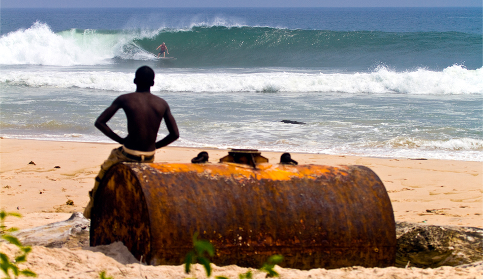 "Gabon. Left point at Mayumba, with Randy Rarick laying into a bottom turn. Since the airport closed a few years ago, the three-day bush taxi journey from Libreville through the great tropical forest of Central Africa has put off many surfers from southern Gabon, but the waves are definitely there. Surf yourself silly every day at the empty left points, drink local Regab beer every night at Stephanie\'s Le Week-End Bar and try not to think about how long it\'s going to take to get back to Libreville! Image: <a href=""www.tropicalpix.com\"" target=\""_blank\"">Callahan</a>/<a href=\""http://www.facebook.com/pages/SurfEXPLORE/153813754645965\"" target=\""_blank\"">surfEXPLORE</a>"