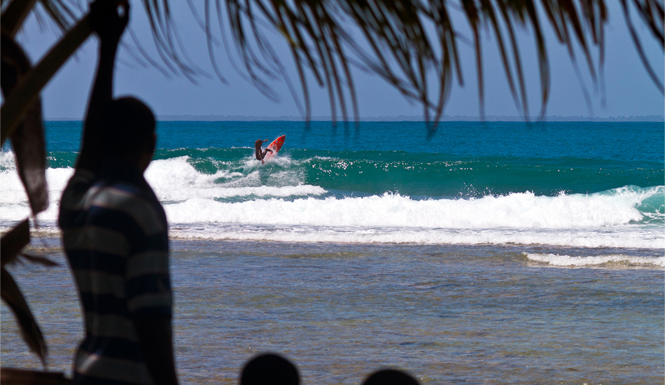 "Haiti. Caribbean Coast, with Icah Wilmot from Jamaica smacking the lip at left reef break. Since the January 2010 earthquake, aid workers have flooded into the country, many of them idealistic evangelical Christians from the States. Some of the aid workers are surfers, enjoying the last unsurfed area in the Caribbean region while helping Haitians recover from the devastation of the quake. Image: <a href=""www.tropicalpix.com\"" target=\""_blank\"">Callahan</a>/<a href=\""http://www.facebook.com/pages/SurfEXPLORE/153813754645965\"" target=\""_blank\"">surfEXPLORE</a>"