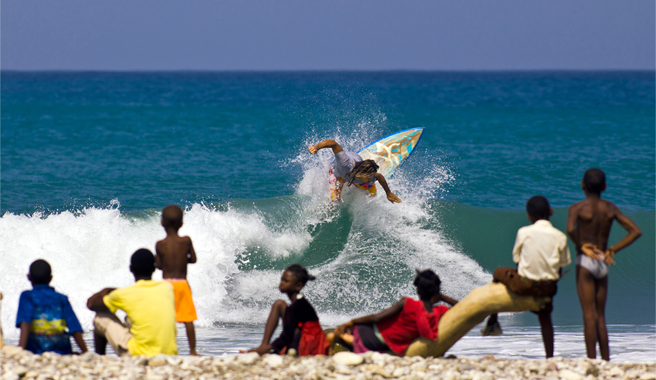 "Haiti. Emiliano Cataldi at a south coast rivermouth. Haiti\'s southern coast abounds with rivermouth spots, gravel bars that hold size and shape on the consistent windswell from the Caribbean Sea. Local village children came out in droves to watch when we surfed this spot, hanging out on the beach screaming their appreciation (or derision) in Kreyol Ayiti dialect and gathering coconuts for apres-surf food and drink. Image: <a href=""www.tropicalpix.com\"" target=\""_blank\"">Callahan</a>/<a href=\""http://www.facebook.com/pages/SurfEXPLORE/153813754645965\"" target=\""_blank\"">surfEXPLORE</a>"