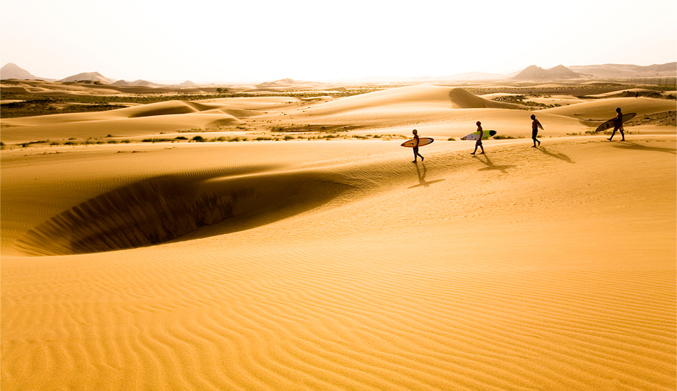 "Oman. Walking in the Wahiba Dunes, towards the Arabian Sea. After some time in the desert, it\'s easy to understand why desert people think of the dunes as a kind of sea - without trees, rocks or landmarks of any kind, it\'s similar to traveling over water, but a sea of sand. Bring a compass, people have gotten very disoriented and vanished forever a short distance away from camp, wandering among the dunes. Image: <a href=""www.tropicalpix.com\"" target=\""_blank\"">Callahan</a>/<a href=\""http://www.facebook.com/pages/SurfEXPLORE/153813754645965\"" target=\""_blank\"">surfEXPLORE</a>"