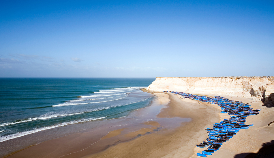 "Western Sahara. Right points don\'t come any better than this setup in Western Sahara, north of Dakhla. Sand bottom perfection, north Atlantic groundswell, no one surfing. There\'s a massive fishing camp on the bluff of Moroccan fishermen who come for octopus season - they have ten or so days to catch a year\'s worth of octopus for export to Europe; so when fishing season is on, forget about surfing - too many boats and serious people working to feed their families and make some money. There are plans to enclose the point with a long jetty - which would make fishing much easier but destroy the wave, one of the best in North Africa. Image: <a href=""www.tropicalpix.com\"" target=\""_blank\"">Callahan</a>/<a href=\""http://www.facebook.com/pages/SurfEXPLORE/153813754645965\"" target=\""_blank\"">surfEXPLORE</a>"