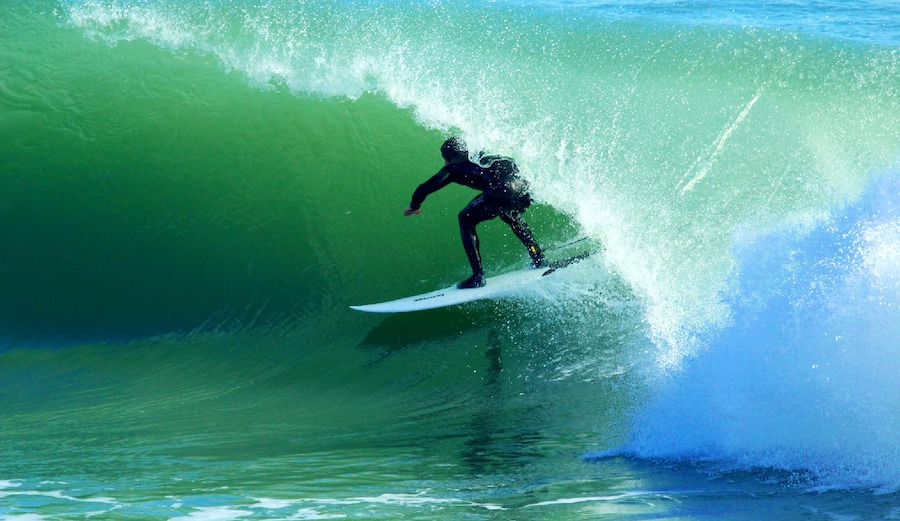 Who said German's can't surf? Lennart Girard rushes dreamy tubes like this for breakfast. Santo Amaro, Portugal. 2/8/17. Photographer: Helder Nogueira
