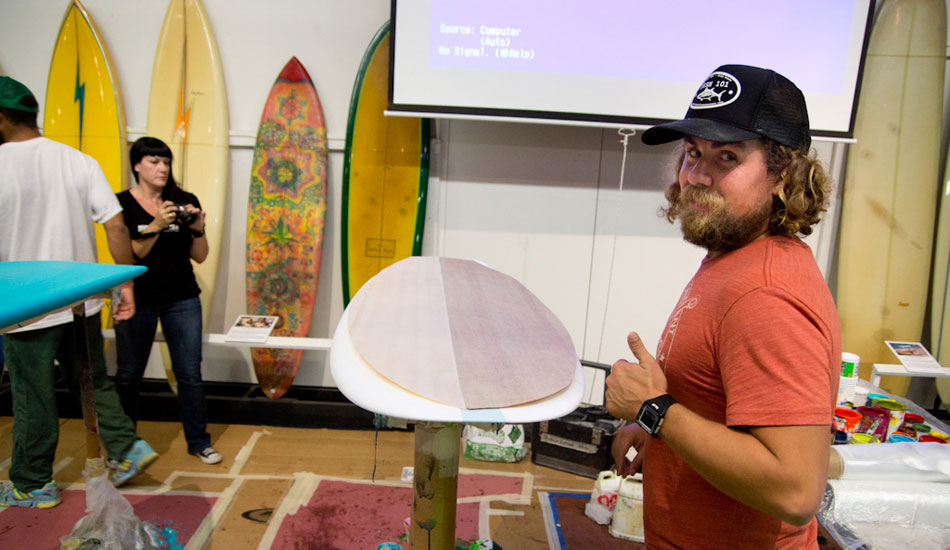 Chiron Stewart of MAC Glassing gives thumbs-up on a bamboo deck for an asymmetric Brink surfboard
