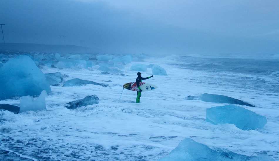 Mid winter Iceland. Snow fall, only about four hours of light, a wind chill way below freezing and a field of Icebergs to get through before you can surf. Ian Battrick getting ready for a standard solo session.