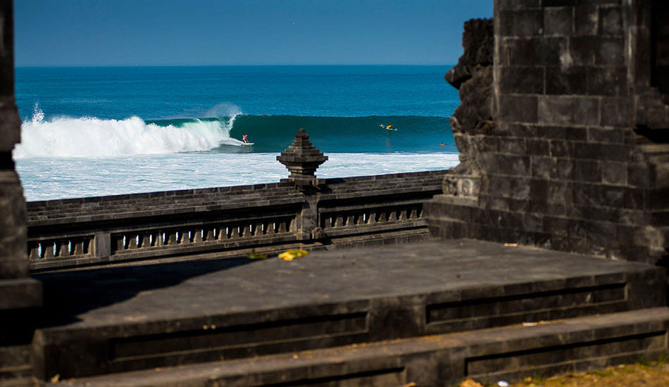 """Just one of the many waves in Bali that breaks right out front of some sort of amazing architectural piece. It's refreshing to get to a place that essentially does all the work, where even just a bottom turn can make an amazing photo and no insane action is needed. Photo: <a href=\""""http://trevormoran.com/\"""">Trevor Moran</a>"""