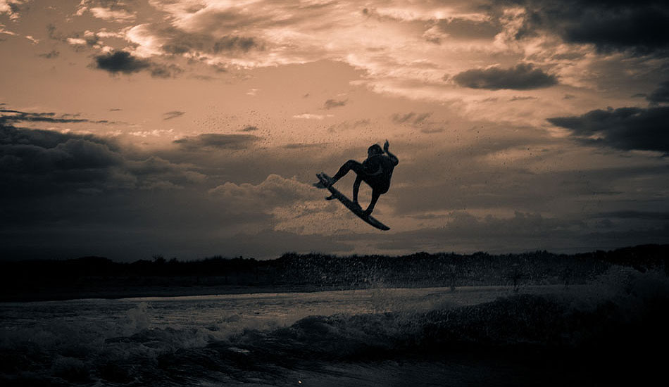 """During the majority of the year, the waves in New Jersey suck, and interesting compositions can be hard to come by. In order to keep shooting, we sometimes have to force it. This is Andrew Gesler doing a tow-at session between a series of summer thunderstorms. It\'s a bit of a testament to how we can still make eye-catching imagery even when the weather and waves are terrible. Photo: <a href=\""""http://trevormoran.com/\"""">Trevor Moran</a>"""