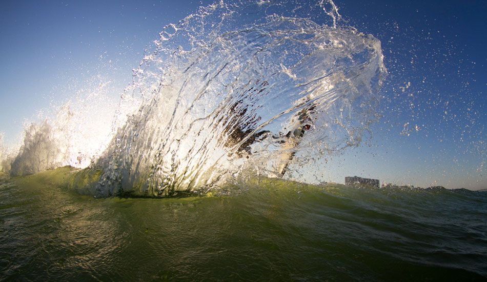 """Back home again for some downtime. Tyler and I going for something different. I really like how the light hits the spray but you can still make out the surfer. Photo: <a href=\""""http://thewildlyfe.com/\"""">Eddie Compo/TheWildLyfe</a>"""