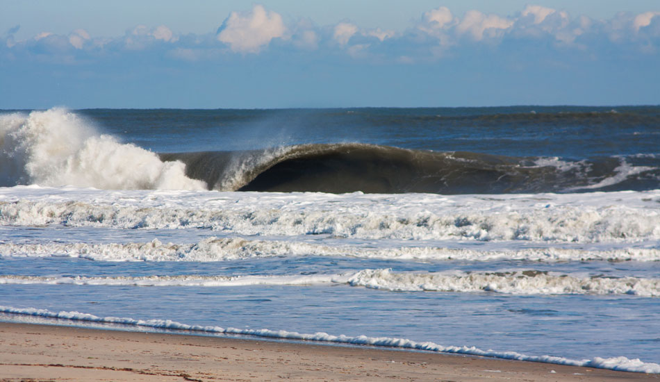 """The Outer Banks is an amazing place. You can pull off and possibly find world class waves at any turn. It's so wide open and constantly changing. This is a random north swell hitting a random sandbar on the side of the road.  Photo: <a href=\""""http://thewildlyfe.com/\"""">Eddie Compo/TheWildLyfe</a>"""