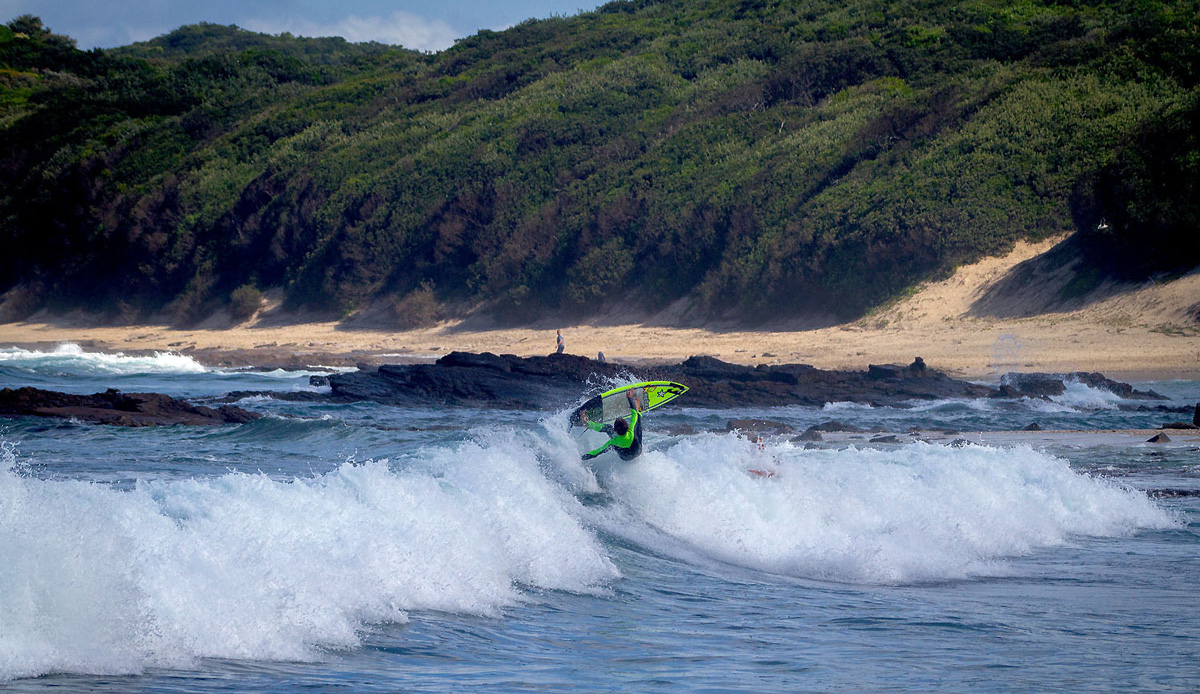 Micro grom, Mitch du Preez throwing everything into his last turn. Photo by: Tyerell Jordaan