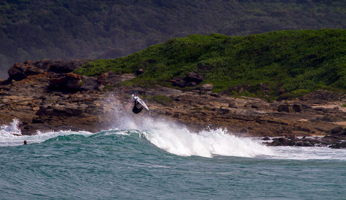 Michael Monk flipping out, just the other side that hill is another bay for another day. Photo by: Tyerell Jordaan