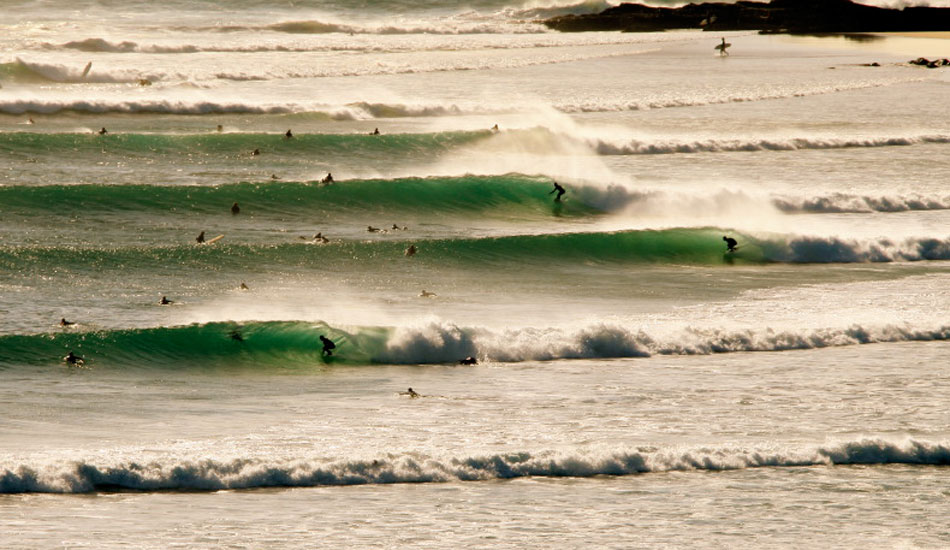 """This is a pretty crazy moment from Kirra Hill above Queensland\'s infamous Superbank. This shot was taken at about 7:30am as the tide drained out. Consistent cyclone swells and large crowds of highly skilled surfers make this a fairly common sight in this part of the world. Photo: <a href=\""""http://www.korduroy.tv\"""" target=_blank>Cyrus Sutton</a>."""