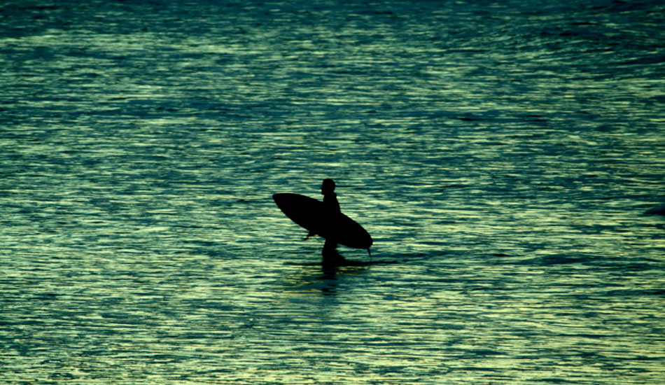 """I really like this shot for some reason. The flat beach and area of receding water remind me of so many low tide, sunset sessions. This is Beau Young getting out after a good evening of waves at Kirra. Photo: <a href=\""""http://www.korduroy.tv\"""" target=_blank>Cyrus Sutton</a>."""