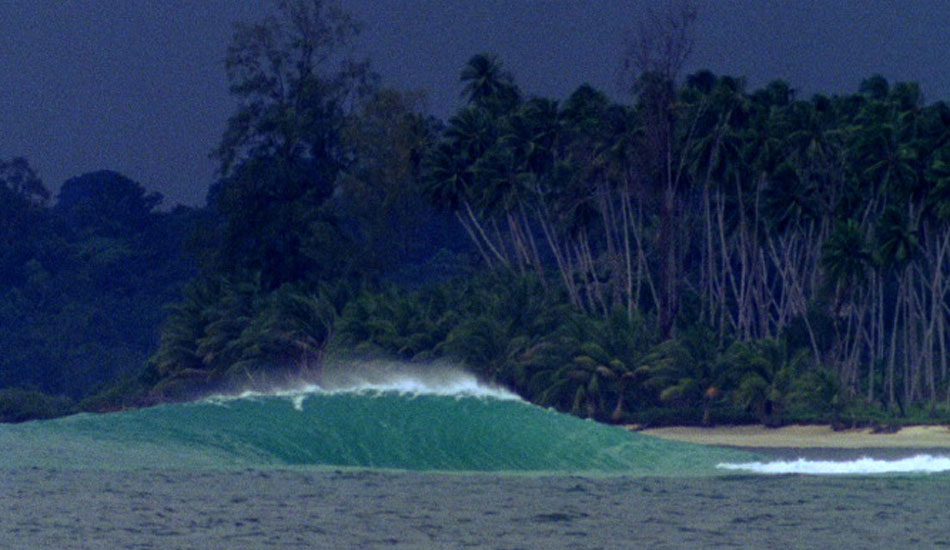 """We were (to the best of our knowledge) the first ones to surf this little slab. These small Northern Indonesian islands were first discovered by the crew of our boat only a couple of weeks prior and I can remember sitting on the beach waiting for another set to provide Rasta and Daniel Thomson with more small right peelers when across the bay, a peak popped up and spat over a submerged island. I swung my lens around and refocused just as the second wave did the exact same thing. After a third wave followed suit, I called out to the boat guy in the channel and 30 minutes later we were on the peak for the rest of the afternoon. Photo: <a href=\""""http://www.korduroy.tv\"""" target=_blank>Cyrus Sutton</a>."""