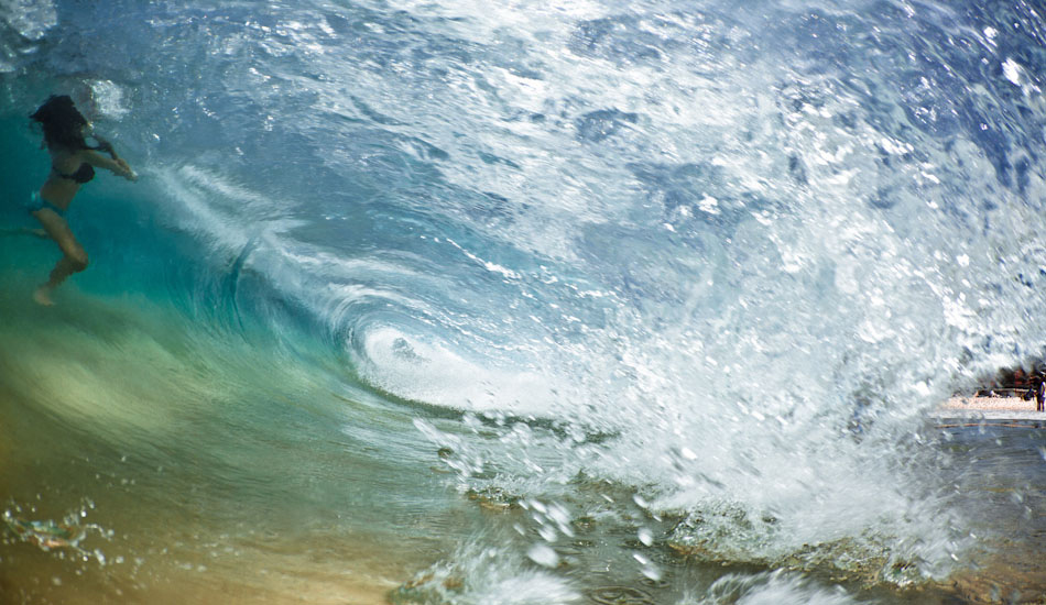 """Frozen. A girl is almost frozen in the face of the breaking wave at Coogee Beach, Sydney. """"This day was barely waist high. I'm super stoked on the photo though - I\'d love to say it was totally planned and choreographed, but it\'s not.\"""" Photo: <a href=\""""http://www.marktipple.com/\"""" target=_blank>Mark Tipple</a>."""