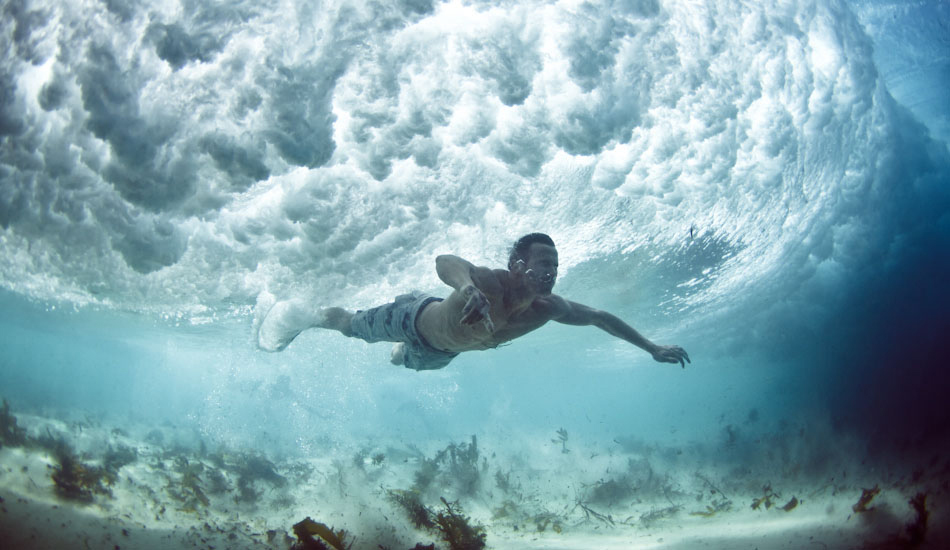 """Streak. A swimmer narrowly avoids the breaking wave above at Bronte Beach, Sydney. I\'ve tried to recall what happened, but I can\'t. Basically a wave came, I dove under, he dove under and I pressed the button. Turned out cool.\"""" Photo: <a href=\""""http://www.marktipple.com/\"""" target=_blank>Mark Tipple</a>."""