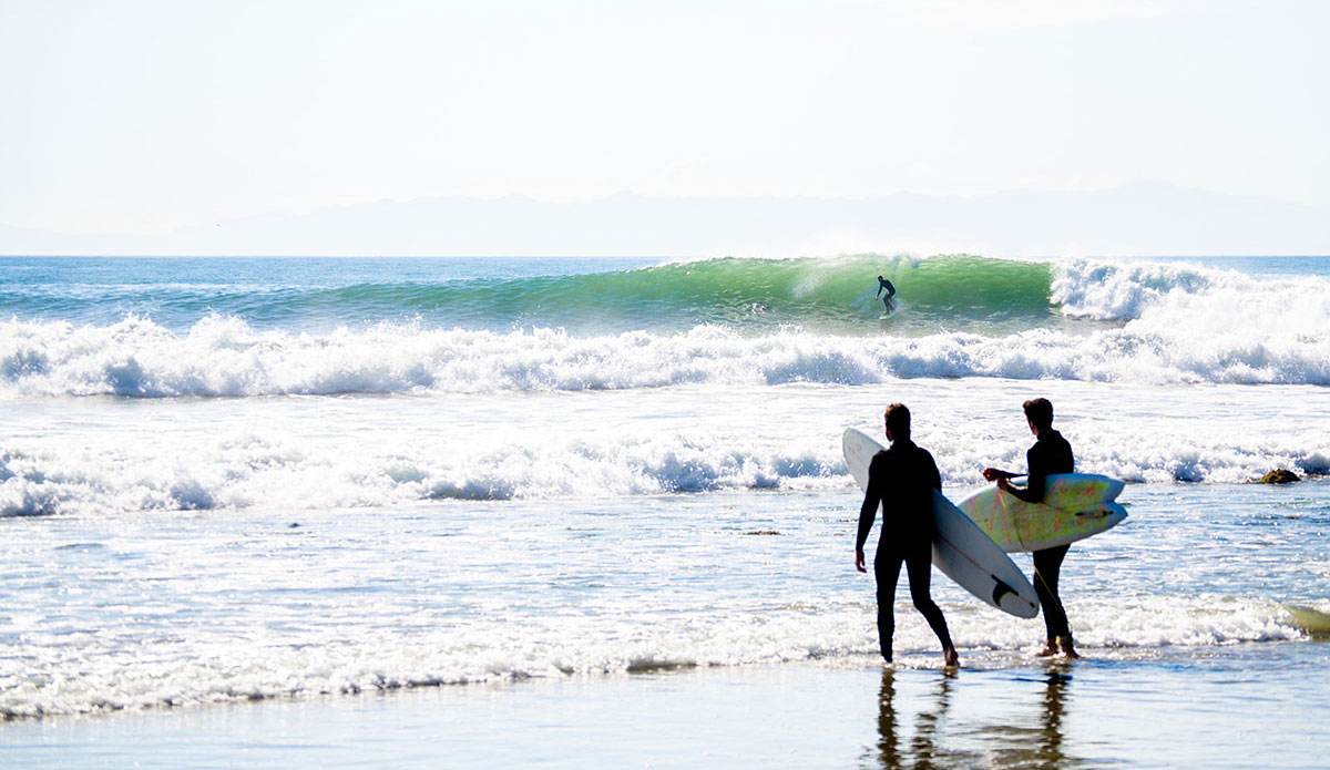 "A few surfers heading out and liking what they see. Rincon, CA. Photo: <a href=""http://www.victoriamouraphoto.com/#0\""> Victoria Smith</a>"