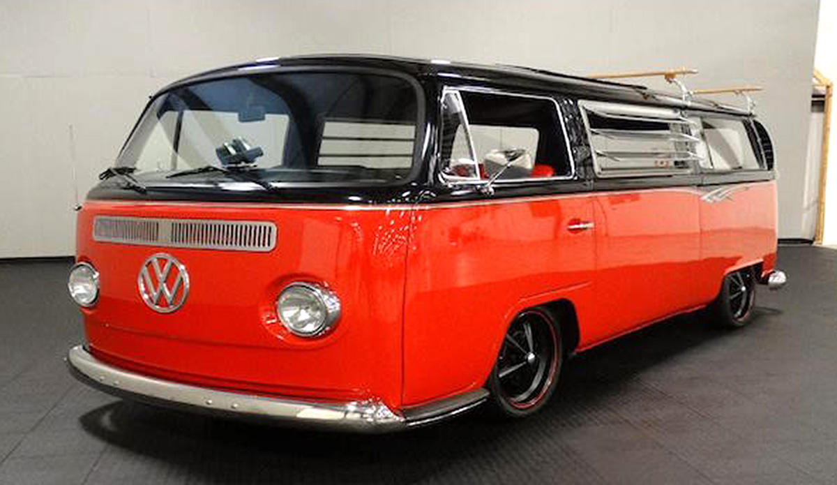 1969 VW Bus with a 4 cylinder engine and manual transmission. Exterior color is a black top with a red middle and bottom with black wheels.