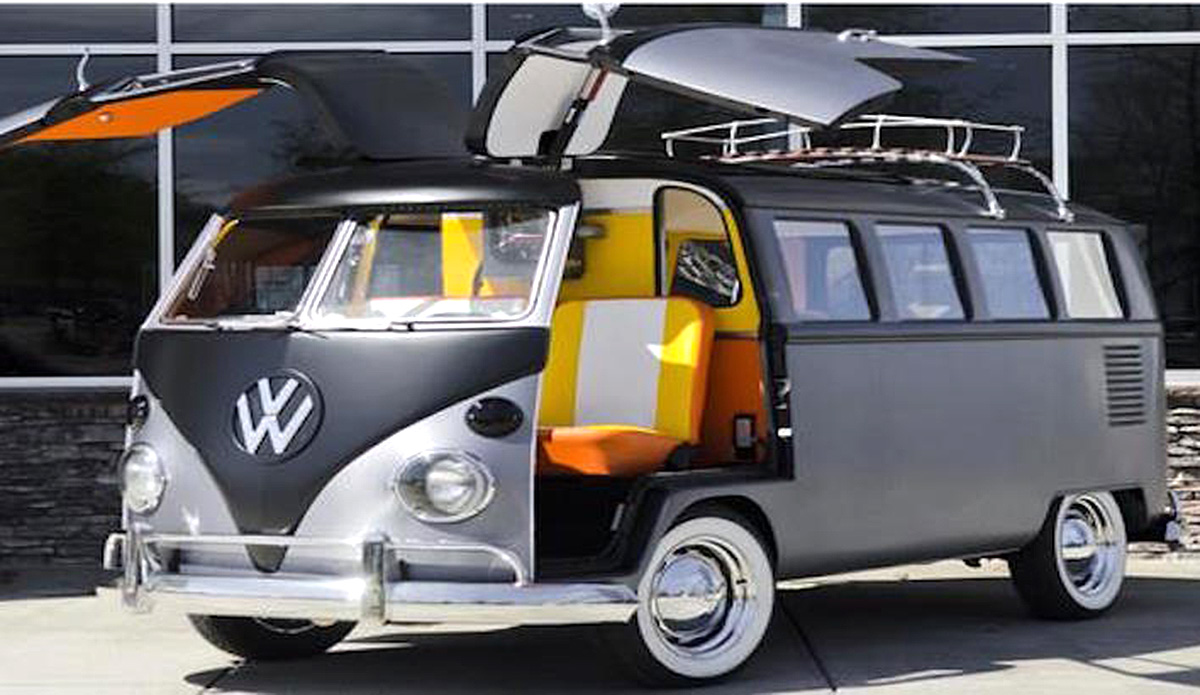 1967 VW Bus with a 'Back to the Future' custom theme. Custom build gull-wing front doors with a 4 cylinder engine and manual transmission. Exterior color is brushed steal wrap with an orange interior.