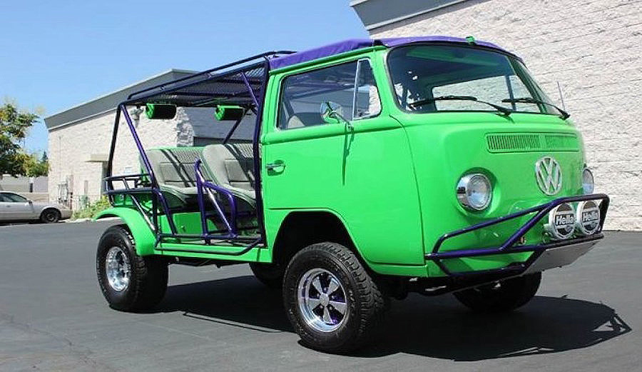 1974 VW Van Party Bus, customized for off roading. Comes with a 2 liter Subaru engine and a green exterior color and grey cloth interior.