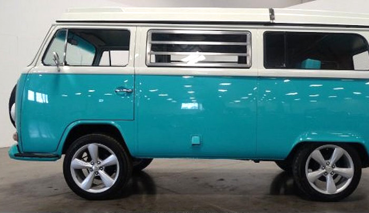 1972 VW Bus with a new 1700cc 4 cylinder engine, manual transmission and custom wheels. The exterior is a tropical turquoise / indigo ivory and the interior is indigo ivory.