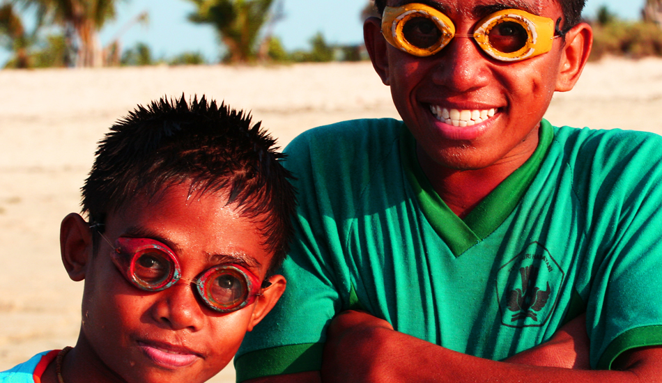 Local kids dive for lobster and octopus with homemade goggles. Image: Murphy