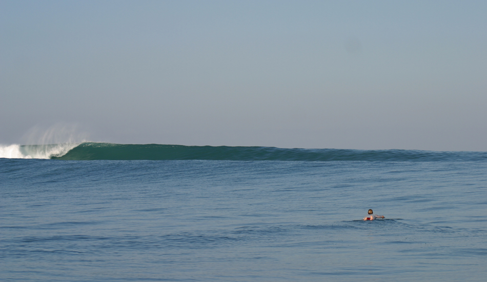 This is my favorite photo from the trip, and possibly favorite photo of me ever. How many people get to paddle out to an empty line up like this. I snuck out early while everybody was sleeping. My brother is still upset with me! Image: Murphy