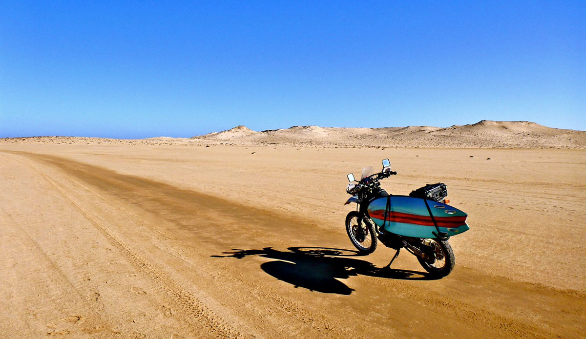 "A long road ahead in the Sahara Desert. Photo: <a href=\""http://bugsonmyboard.org/\"">Gary Conley</a>"