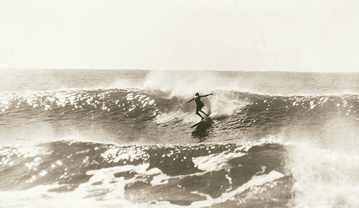 """Nat at Collaroy c. 1961. I'd borrowed a camera and telephoto lens from my friend Ron Perrott who was one of the pre-eminent Australian surf photographers of the day. We happened to be at Collaroy in Sydney, and a gangly kid nicknamed Gnat happened to be in the water. Not a bad subject for your first surfing pictures. Photo: <a href=\""""http://www.johnwitzig.com.au/\"""">John Witzig</a>"""