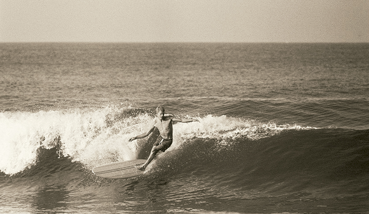 """Midget Farrelly at Palm Beach c. 1964 Midget was the first great hero of Australian surfing. If his influences were Californian (the Phil Edwards multi-stringered boards and the Peter Van Dyke drop-knee cutback), he put the whole package together with a great individual style.  Photo: <a href=\""""http://www.johnwitzig.com.au/\"""">John Witzig</a>"""