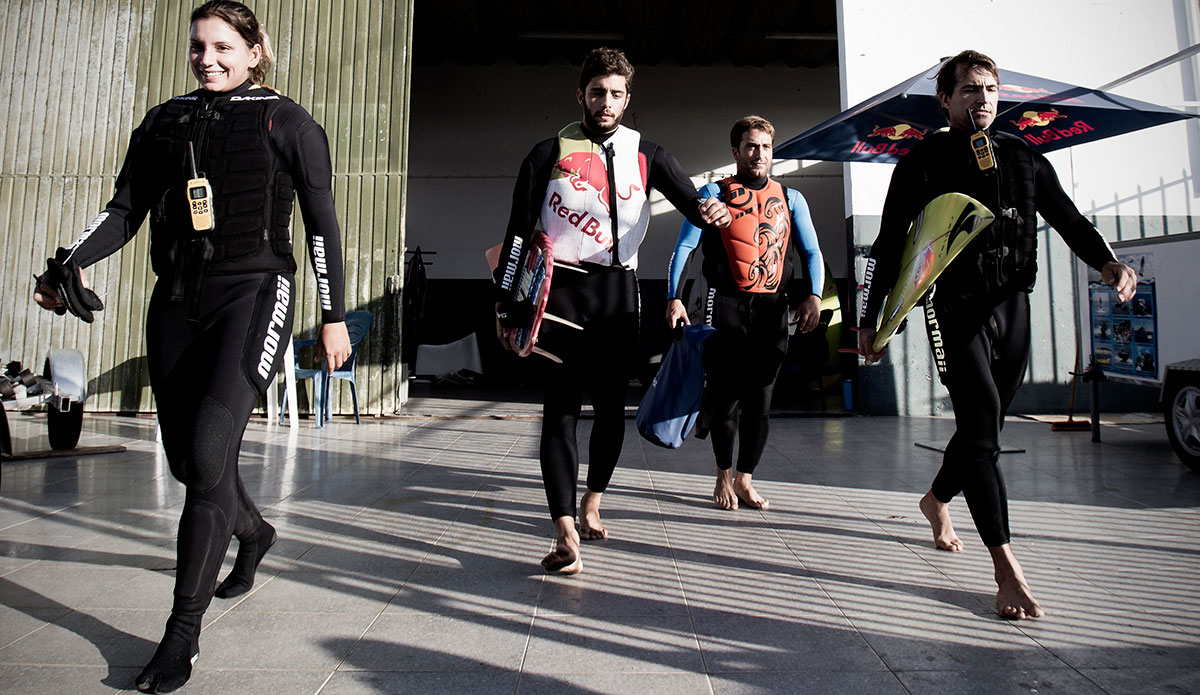 """Cue Little Green Bag for Ms. Gold and her Nazare Dogs: Pedro Scooby, Felipe """"Gordo"""" Cesareno and Carlos Burle. Maya Gabeira is an interesting gal. There's a lot of pretty Brazilian girls working in food trucks along the North Shore, so how and why did this one become such a charger, willing to risk life and limb at Nazare and Teahupoo and elsewhere, nearly drowning at least twice, but never backing down? When you understand Maya's revolutionary father and her family background, you start to get the picture. Interesting gal. Interesting family. Photo courtesy Red Bull."""