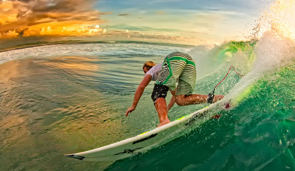 """Tavarua with an injured, yet still ripping Dusty Payne.  Hey, if you\'re gonna get an ass in your face, you might as well compliment it with a glorious sunset. <b>Photo:</b> <a href=\""""http://www.anthonyghiglia.com/\"""" target=_blank>AnthonyGhiglia.com</a>/<a href=\""""http://www.anthonyghigliaprints.com/\"""" target=_blank>AnthonyGhigliaPrints.com</a>"""