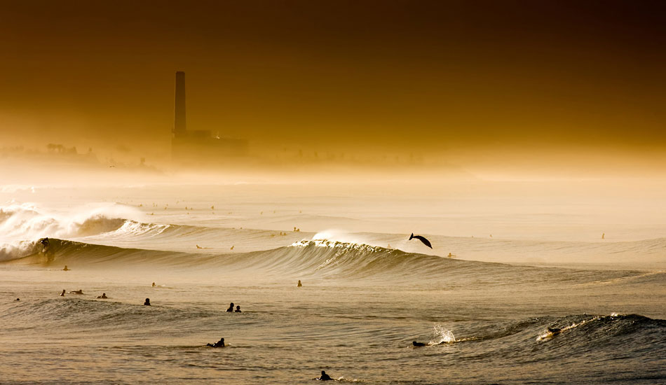 """I see dolphins all the time when I\'m swimming but I have yet to get an image of one that I\'m proud of.  This is probably my favorite dolphin photo.  Shot in Oceanside during a good run of south swell, offshore wind, and wildfire smoke. <b>Photo:</b> <a href=\""""http://www.anthonyghiglia.com/\"""" target=_blank>AnthonyGhiglia.com</a>/<a href=\""""http://www.anthonyghigliaprints.com/\"""" target=_blank>AnthonyGhigliaPrints.com</a>"""