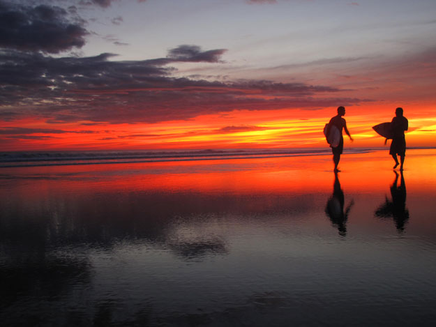 Two surfers enjoy (and contribute to) Nicaraguan surf culture at sunset in Popoyo. Photo: Zach Weisberg