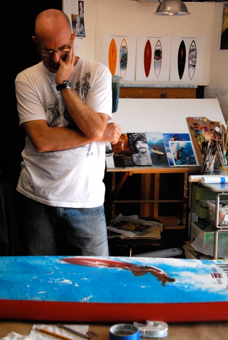 Portrait of the artist: Phil Roberts as he works on the Pipeline Masters commemorative board.